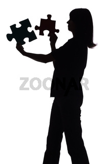 silhouette of woman with puzzle