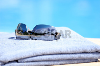 Sunglasses on towel