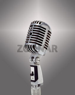 Mikrofone, The old microphone over grey background