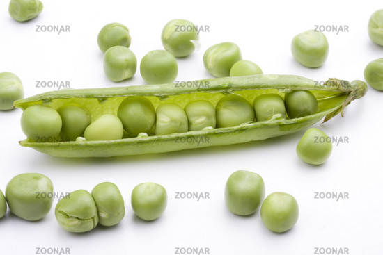 fresh green peas on a white background