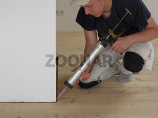 Malergeselle Schlauchbeutelpresse mit Spritzkork