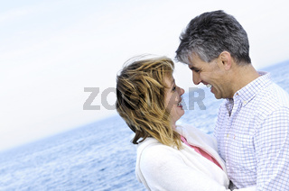 Mature romantic couple at seashore