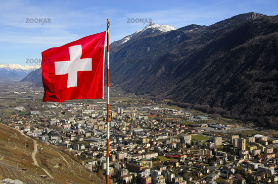 The Swiss flag is flying over Martigny in the Rhone valley