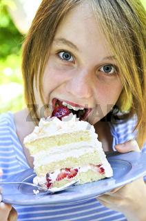 Girl eating a cake