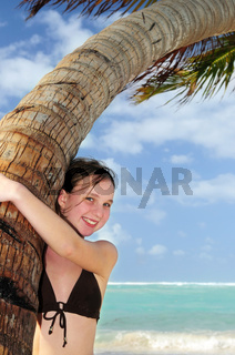 Young girl with seashell