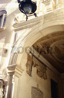 San Marco, Stone carved archway, metal lamp above, Venice, Italy