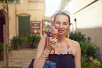 Smiling attractive woman enjoying an ice cream