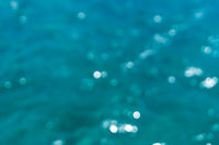 blurry reflections on ocean surface for backgrounds