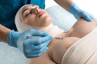 Girl her head bandaged at plastic surgeon