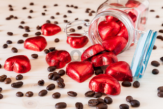 Red hearts in a glass jar and coffee beans