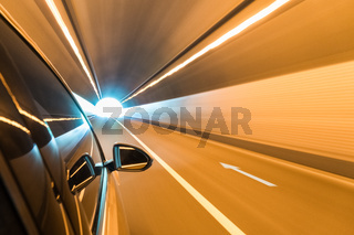 car driving fast exit the tunnel
