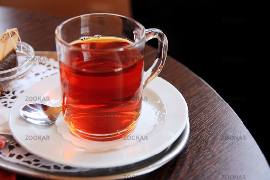 glass of black tea with teabag