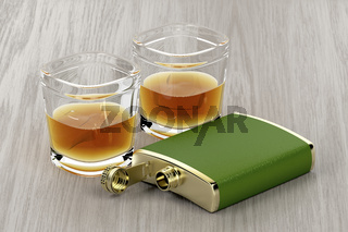Green hip flask and glasses of whisky