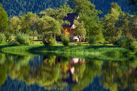 Small wooden bungalow on bank of bay on South part of Lake Teletskoye  in Altay