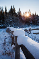 Snow covered wooden fence on a cold winter's day