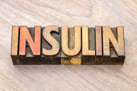 insulin word abstract in wood type