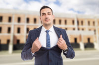 Real estate agent manager showing chest as power and success concept
