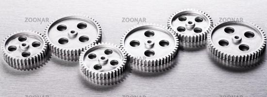 Silver gears in a row