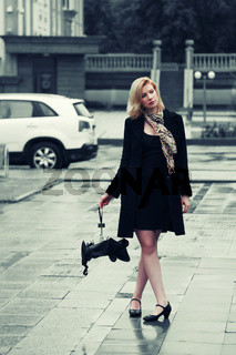 Young fashion woman with umbrella in the rain