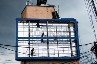 Men working on billboard