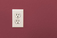 Electrical Sockets In Colorful Burgundy Wall