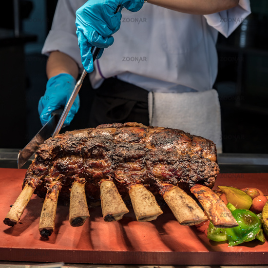 Chef carving beef