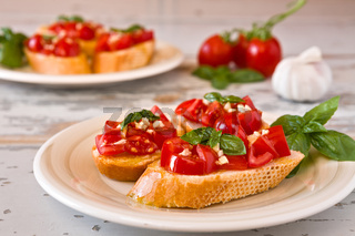 Italian bruschetta with tomato, basil and garlic on a plate