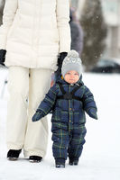 Winter portrait of toddler boy with mother