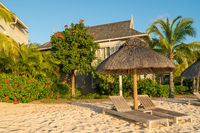 beach with wooden parasol garden and bungalow