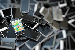 Choose mobile phone. Heap of the different smartphones and one with gps application on the screen. Modern technology concept background.