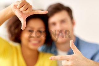 happy couple hands making frame gesture