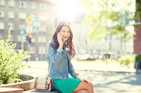 happy young woman or girl calling on smartphone
