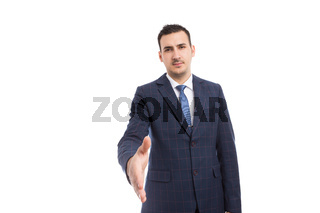Banker broker or business man making handshake gesture as deal partnership concept