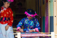 Lijiang Woman Traditional Garb Naxi Weaving Loom