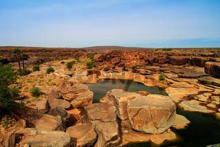 Panorama of rocky pond on Adrar plateau Mauritania