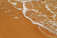 Sea beach sand with foamy wave a lot of space for text