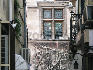 decorated window in medieval palace in Avignon