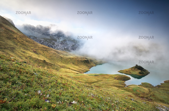 misty morning on alpine lake Schrecksee
