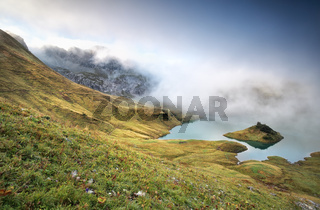 misty morning on alpine lake Schrecksee