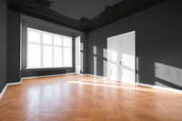 Empty room with parquet floor after renovation