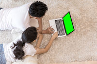 Couples using laptop bedroom