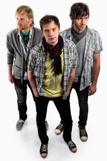 Three handsome guys indoors