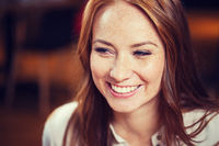 smiling happy young redhead woman face