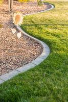 Beautiful Concrete Coping Along Lush Green Grass in Yard.