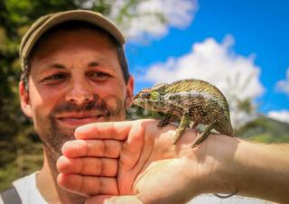 Man and chameleon