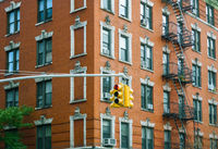 Building facade and traffic light in New York City