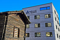 Traditional Valaisian storehouse in front of the modern youth hostel wellnessHostel 4000, Saas-Fee,