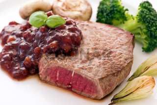 Steak with cowberry sauce