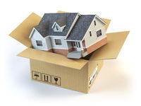 Moving house. Real estate market. Delivery concept. Cardboard box and home isolated on white.