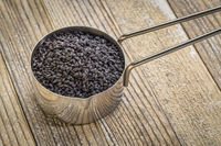 scoop of black cumin seeds